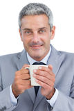 Content businessman holding mug Royalty Free Stock Photography