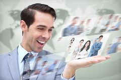 Content businessman looking at pictures Stock Photo