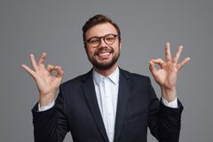 Content businessman meditating in happiness royalty free stock photo
