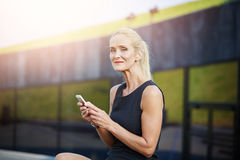 Content businesswoman using mobile phone Stock Image