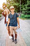 Loving young couple with map on street royalty free stock photography