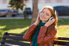 Content cheerful woman listening to music with eyes closed Royalty Free Stock Photography