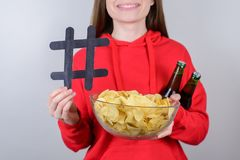 Content concept. Cropped closeup photo picture of satisfied cheerful person people holding snacks in hands showing sign signal. Symbol gray background royalty free stock photography