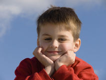 Content, contemplating or just thinking. A boy with a look of contentment Stock Photography