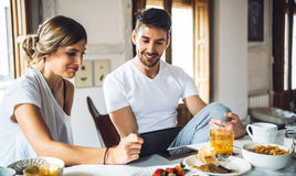 Content couple having breakfast together Royalty Free Stock Photos