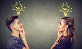 Content couple having great idea. Young people men and women posing together enlightened with idea looking positive Royalty Free Stock Photo
