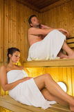 Content couple relaxing in a sauna Royalty Free Stock Photos