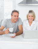 Content couple using laptop in the morning Royalty Free Stock Photo