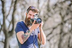 Content creator. Man bearded hipster photographer. Photographer with beard and mustache. Man with long beard shooting. Photos. Manual settings. Photographer royalty free stock images
