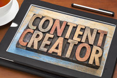 Content creator  words in wood type. Content creator - word abstract in vintage letterpress wood type printing blocks on a digital tablet Royalty Free Stock Photos