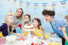 Celebrating kids birthday party stock image