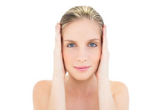 Content fresh blonde woman covering her ears Royalty Free Stock Photos