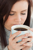 Content girl drinking a cup of coffee Royalty Free Stock Photos
