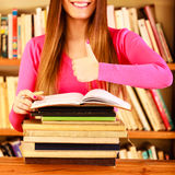 Content girl student in college library Royalty Free Stock Images