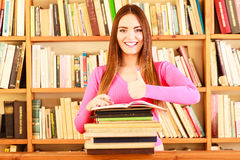 Content girl student in college library Stock Image