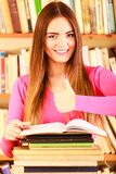 Content girl student in college library Royalty Free Stock Image