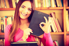 Content girl student in college library Stock Images