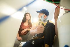 Plumber explaining reason of clogged drains royalty free stock images