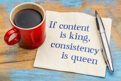 Content is king, consistency queen - napkin concept. If content is king, consistency is queen - blogging and social media tip - handwriting on a napkin with a stock photos