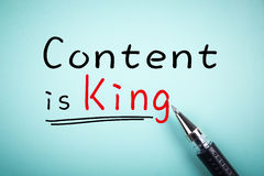Content is King. Text Content is King with underline and a ball pen aside Stock Photos
