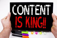 Content Is King text written on tablet, computer in the office with marker, pen, stationery. Business concept for Business Marketi. Ng Online Media white Royalty Free Stock Photo