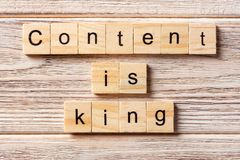Content Is King word written on wood block. Content Is King text on table, concept royalty free stock photos