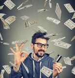 Content man having money compensation Royalty Free Stock Photos