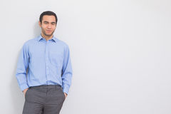 Content man leaning against a wall hands in the pockets Royalty Free Stock Photo