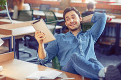 Content man sitting at the table Royalty Free Stock Photography