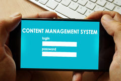 Content Management System CMS. Hands holding phone with Content Management System CMS royalty free stock photos