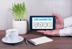 Content Management System. Digital tablet computer with  screen in male hands Stock Image