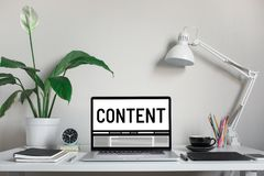 Content marketing concepts with text on computer laptop and accessories on worktable stock photos