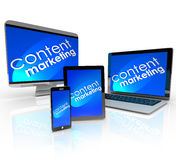 Content Marketing Digital Outreach Phone Tablet. Content Marketing words and background on computer devices -- laptop, desktop, smart phone and tablet -- to Royalty Free Stock Photos