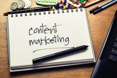 Content Marketing. Handwriting of Content Marketing word in notebook on the wood table Royalty Free Stock Photo