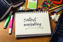 Content Marketing. Handwriting of Content Marketing word in notebook on the wood table Stock Images