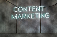 Content marketing. Neon text spelling content marketing against a wall stock photos