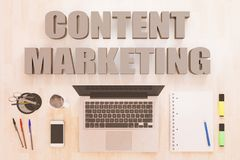 Content Marketing text concept. Content Marketing - text concept with notebook computer, smartphone, notebook and pens on wooden desktop. 3D render illustration Royalty Free Stock Photography