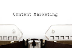 Content Marketing Typewriter. Content Marketing typed on white paper on old typewriter royalty free stock photography