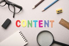 Content marketing word with equipment. Royalty Free Stock Photos