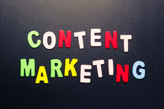 Content marketing. Word topic in cut wood letter Royalty Free Stock Photos