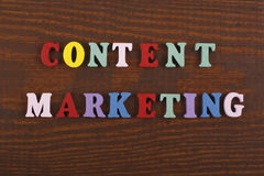 CONTENT MARKETING word on wooden background composed from colorful abc alphabet block wooden letters, copy space for ad stock image