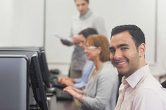 Content mature student sitting in computer class Stock Photos