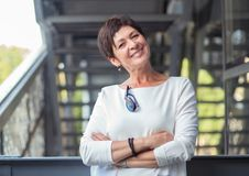 Content mature woman smiling royalty free stock photography