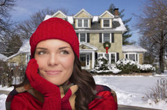 Content Mixed Race Woman in Winter Clothing Outside in Snow Stock Image