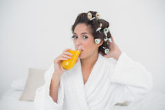 Content natural brunette drinking glass of orange juice Stock Photo