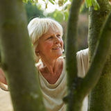 Content old woman in the nature Royalty Free Stock Image