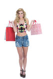 Content retro blonde model carrying shopping bags Stock Photos