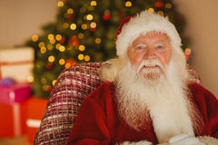 Content santa relaxing on the armchair Stock Image