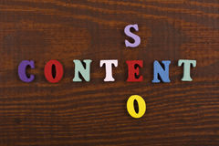 CONTENT SEO word on wooden background composed from colorful abc alphabet block wooden letters, copy space for ad text royalty free stock photography