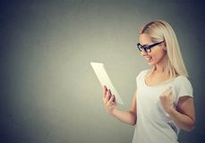 Content smart woman with tablet royalty free stock photography